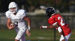 Charlie McKee #7, Oceanside quarterback, runs the ball