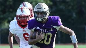 Kyle Messina of Sayville cuts back during a
