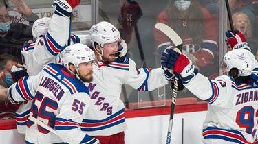 New York Rangers' Chris Kreider (20) celebrates with