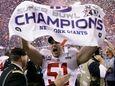 Giants long snapper Zak DeOssie (51) celebrates after