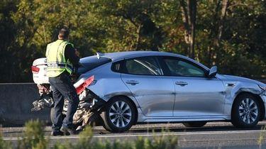 Suffolk Police investigators at the scene of a