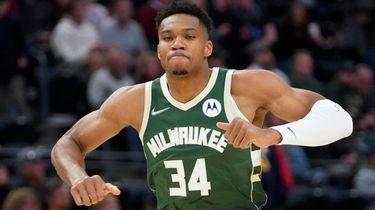 Milwaukee Bucks forward Giannis Antetokounmpo runs up the