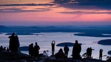 Early-rising visitors to Acadia National Park await the