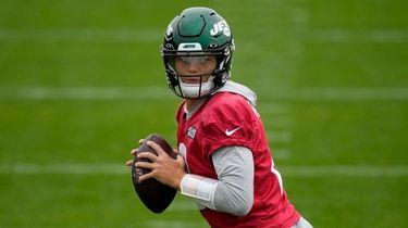 Jets quarterback Zach Wilson takes part in practice