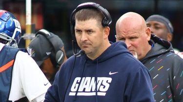 Giants head coach Joe Judge looks on from