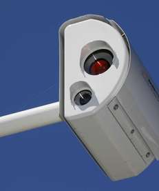 A red light camera at an intersection on