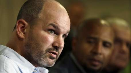 Former NFL player Kevin Turner, left, speaks as