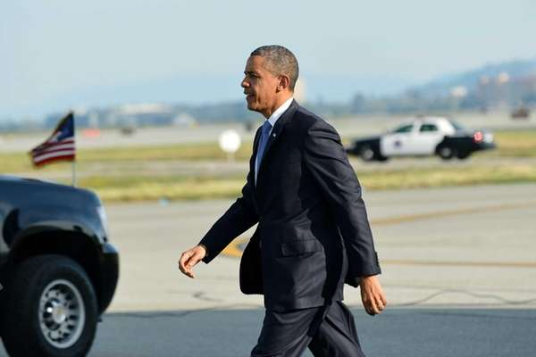U.S. President Barack Obama walks to his car