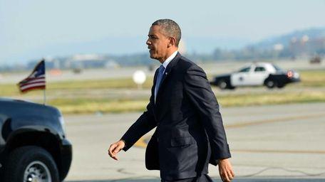 U.S. President Barack Obama walks to his car