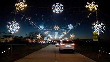 Motorists drive through the 'Magic of Lights' show