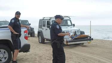 Police at Amagansett beach in June when a