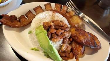 Frijoles con garra comes with rice, fried pork