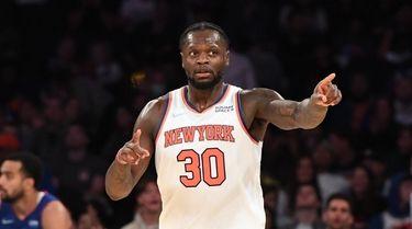 Knicks forward Julius Randle gestures after scoring a