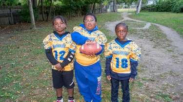 Two of the Roosevelt Rough Riders youth football