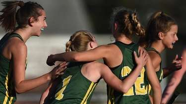 Peyton Phillips #1 of Ward Melville, center, gets