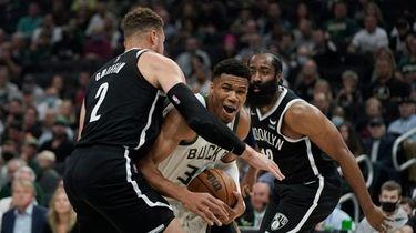 Milwaukee Bucks' Giannis Antetokounmpo goes to the basket