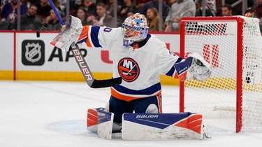 Ilya Sorokin #30 of the Islanders makes a