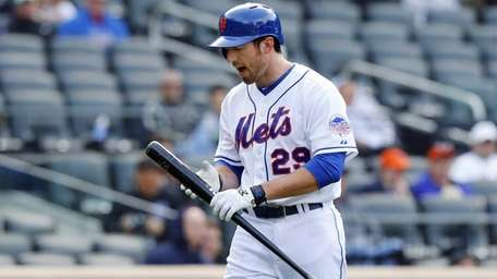 Ike Davis reacts after striking out in the