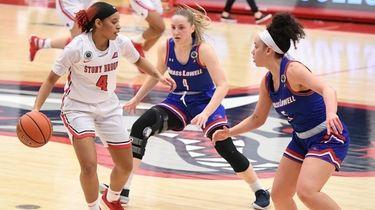 Stony Brook guard Anastasia Warren controls the ball
