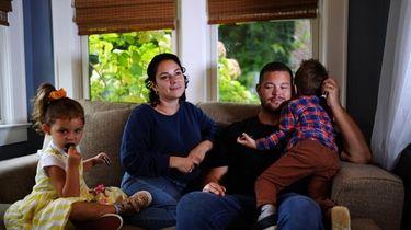 Jennifer Favaro-Farrell, 34, with her husband Ryan and