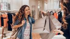 Young woman taking her shopping bags in a