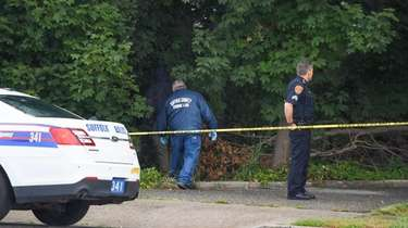 Police at scene where a 15-year-old was slain