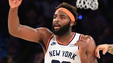 Knicks center Mitchell Robinson reacts after sinking a