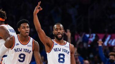 Knicks' Kemba Walker (8) celebrates with RJ Barrett