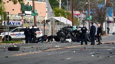 Nassau County police investigate at the crash scene