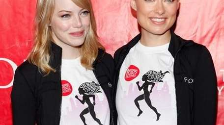 Last year's hosts Emma Stone and Olivia Wilde.
