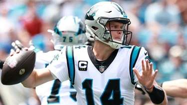 Panthers quarterback Sam Darnold throws the ball during