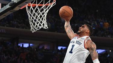 New York Knicks forward Obi Toppin dunks against