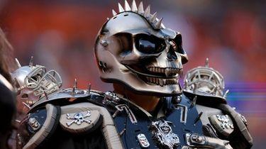 A Las Vegas Raiders fan watches play against