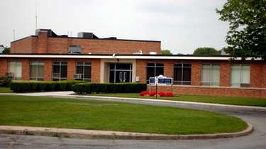 The former Whiporwil School in Hauppauge, where a