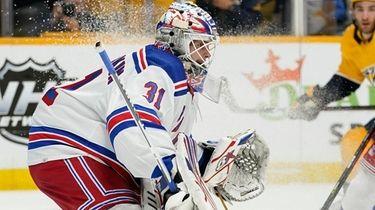 Rangers goaltender Igor Shesterkin blocks a shot as