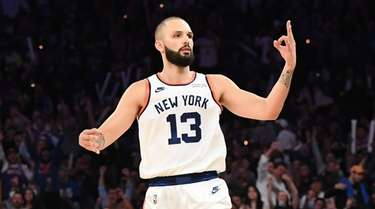 Knicks guard Evan Fournier reacts after he made