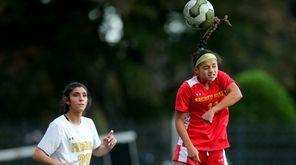 Sacred Heart forward Gabriella Sandoval (11) heads the