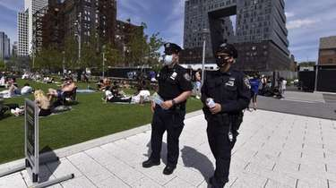 Two NYPD officers patrol Brooklyn's Domino Park as