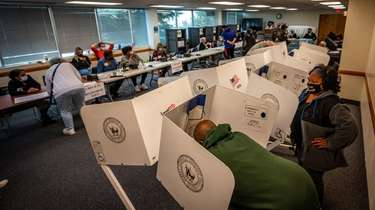 Voters fill out ballots at Huntington Public Library