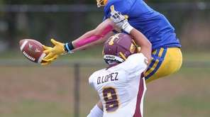 Comsewogue's James Krieg (1) goes up for a
