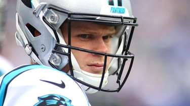 Sam Darnold of the Panthers looks on against