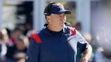 Patriots head coach Bill Belichick walks down the