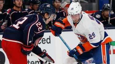 The Blue Jackets' Jake Bean, left, tries to