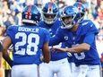 Devontae Booker of the Giants celebrates his fourth-quarter