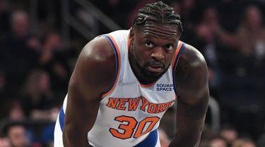 Knicks forward Julius Randle looks on against the