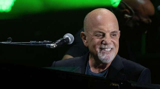 Billy Joel performs at the Formula One Grand