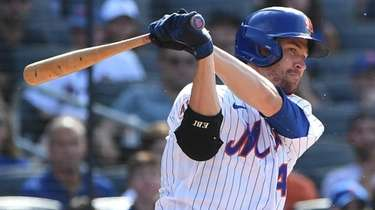 Mets starting pitcher Jacob deGrom bats against the