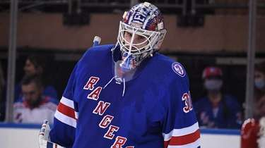 Rangers goaltender Igor Shesterkin looks on against the