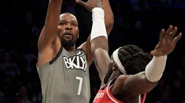 Kevin Durant of the Nets shoots over Montrezl