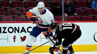Islanders defenseman Zdeno Chara (33) battles with Arizona